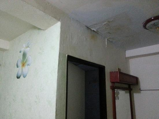 B.M.P. Residence: Damp ceilings and neither ac worked in both rooms!