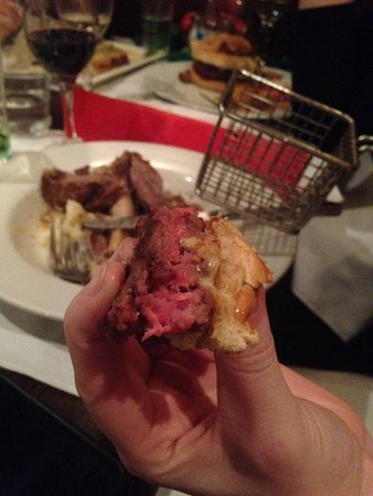 Wolfe's Bar & Grill : Pink burger. Raw?