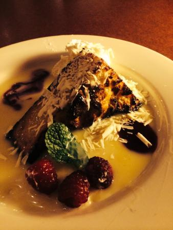 Cafe Bistro: White Chocolate Bread Pudding with raspberry sauce, fresh raspberries and mint leaf