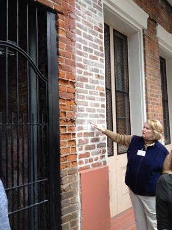 French Quarter Walking Tour: Linda pointing out slave-made bricks