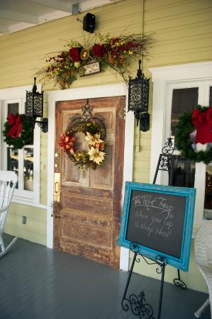 The Tilted Teacup Tea Room and Boutique. Front door took owner 3 weeks to get like this.