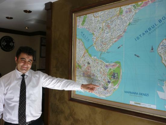 Hotel Seraglio: Kenan pointing to the hotel location on the wall map.