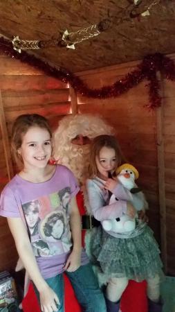 My birthday girl and her sister seeing santa at funways