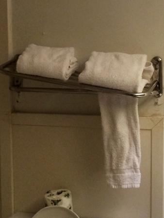 Motel 6 Tulsa Airport #4696: Broken towel rack shelf