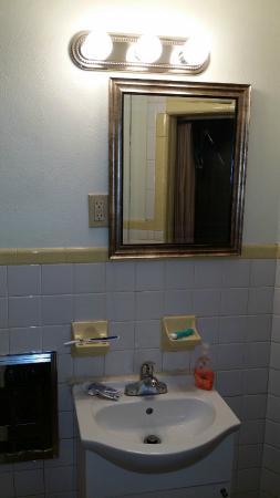 Moon-Lite Motel : Sink in bathroom (from bathroom door).
