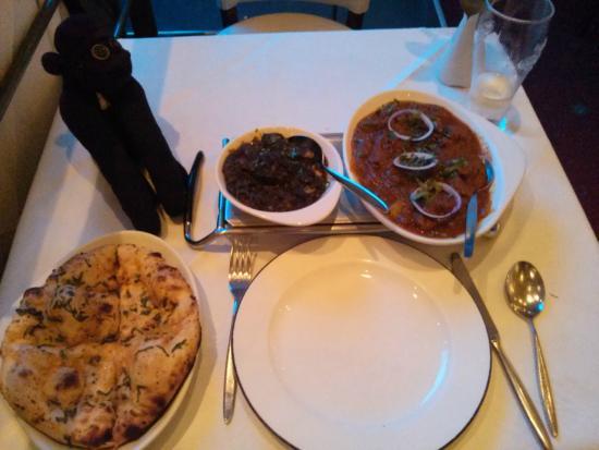 Achari: From L to R, garlic naan, saag paneer, lamb madras