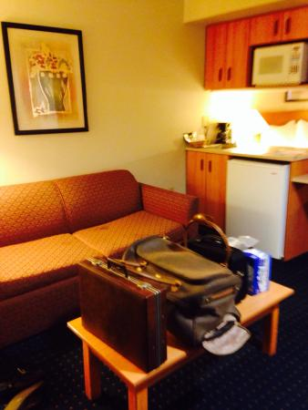Comfort Inn & Suites Salinas: Fold out couch our junk on the coffee table but you can see the sink, fridge and microwave