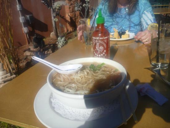 Thai Palace: Rice soup noodles with fresh bean sprouts, celintreo, and green onions in a chicken broth.