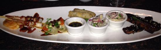 "Roy's Poipu Bar & Grill : Appetizer sampler for 2.  I would just get the ribs or gyoza next time.  The rest was ""good"", bu"
