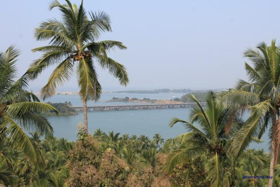 Bekal, India: Confluence of river and the sea from Chandragiri fort