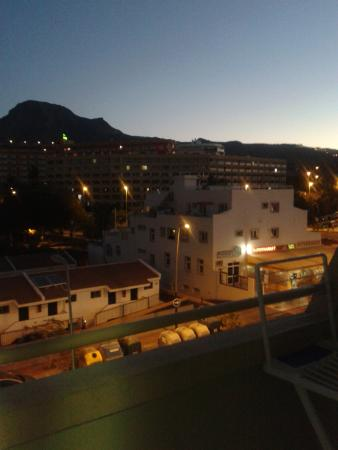 Apartamentos Playazul : view from our apartment, can see the beautiful mountain as the sun is about to come up.