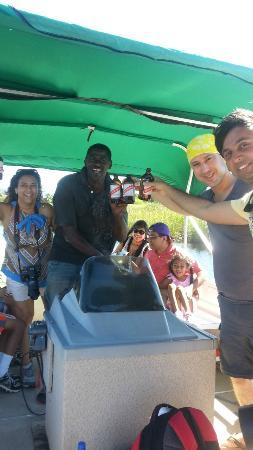Island Pride Day Tours: petting a baby crocodile