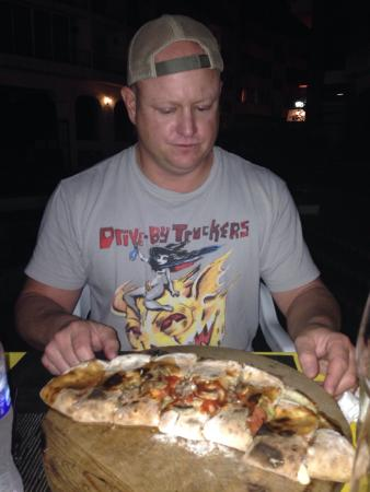 Bella Napoli: Mushroom, artichoke, pepperoni, and sausage calzone...and we ate all of it...so good.