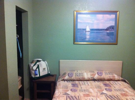 Bayfront Cottages: One of the queen beds with closet