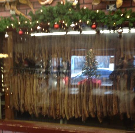 Mahogany Smoked Meats: Various meats being smoked