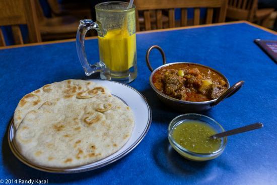 Khorasan Kabob House: Lamb korma, roti, mango lassi, and chutney.