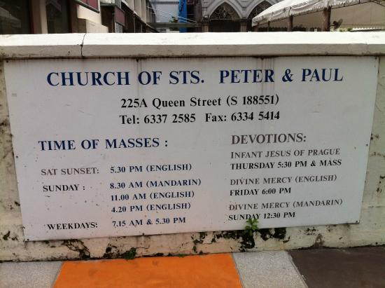 Church of Saints Peter and Paul: Church service information sign at entrance to site