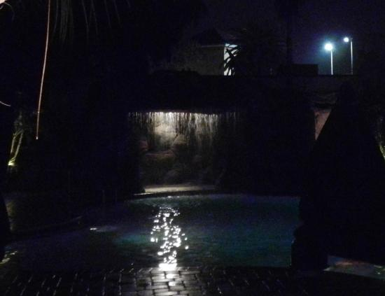 Coconut Cove All Suite Hotel: pool at night