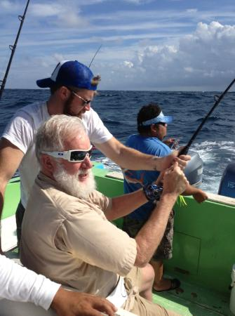 Sport Fishing Center Isla Mujeres: Grandpa getting in on the fishing action