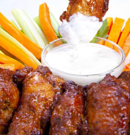 Buffalo Wings Come With Carrot Celery Sticks And A Dipping
