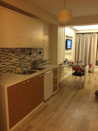 T-Loft Residence : Kitchenette beside living room and flat screen tv