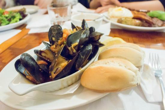 Mi Tierra Restaurant: Mejillones a La Marinara / Marinated Mussels   Steamed mussels with fresh tomatoes, onions, & h