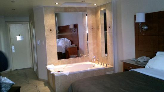 Ramada Rockville Centre Jacuzzi Mirror Reflecting The Bed