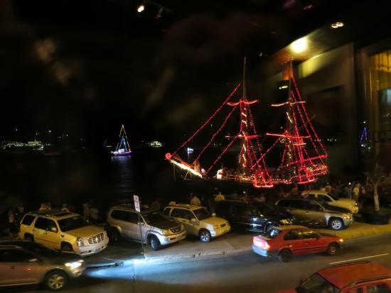 Tavern on the Waterfront: Illuminated boat parade during Miracle on Main St