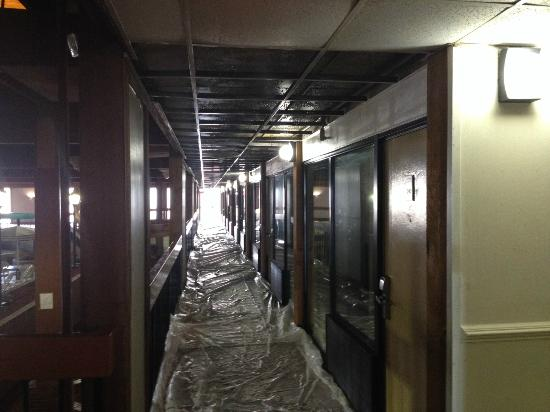 Howard Johnson Fredericksburg South : Second Floor Ceiling collapsed from incoming rain water - floor covered with plastic