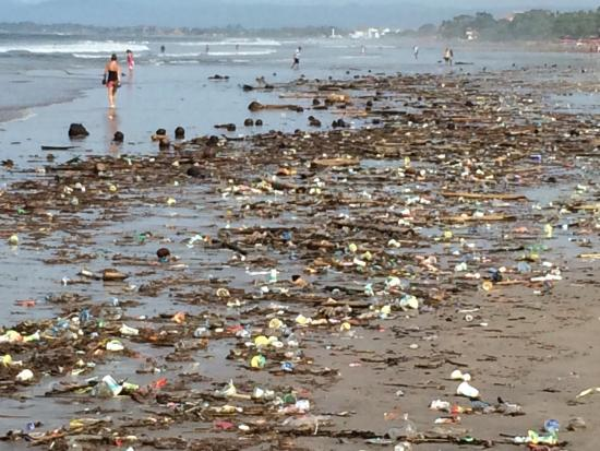 Dirtiest beach ever. The garbage dump of Kuta,Legian and Seminyak in Bali. Disgusting. And this