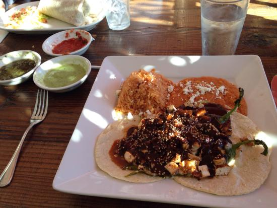 Goleta, Californië: Poblano chiles with chicken mole, red rice, secret ingredient red pinto beans and queso fresco