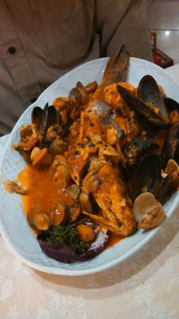 Sea-bass alla Pescatora (tomato sauce with mussels, clams and shrimps)
