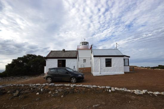 Cape Borda Lighthouse Keepers Heritage Accommodation: Woodward Hut is the small building on the far right. The other hut is the meteorology office for