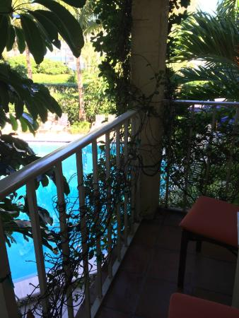 The Caribbean Court Boutique Hotel: Private veranda overlooking the pool
