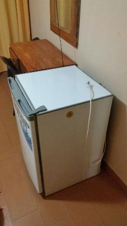 Hotel Tropical: Random refrigerator in the room. Unplugged and no plugs to plug in even if I wanted to use it. M