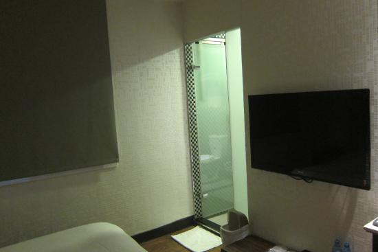 E-Coast Star Hotel: Room with a small window with not much view