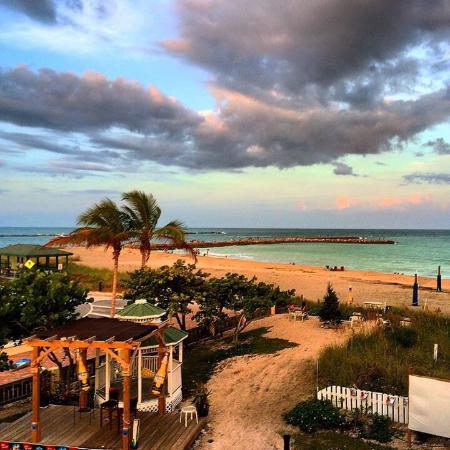 Beachfront Inn : The beach cabana offers volley ball, chair, umbrella rentals and more!