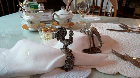 Palmer House Inn: Rooster napkin ring for me the morning person, drooping horse for hubby, still sleepy