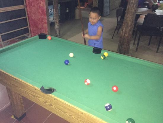 Lusia's Lagoon Chalets : my little nephew trying his hand at the junior pool table, nice touch for the little ones