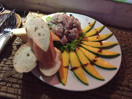 Tuna tartare (Large) mega delicious, ask for a slice of lime to add a ...