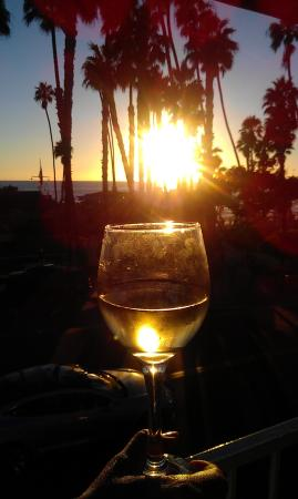 Seahorse Resort: A glass of white wine shimmers in the sunset from the balcony at Sea Horse.