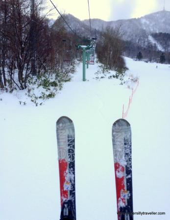 On the lift with rented skis