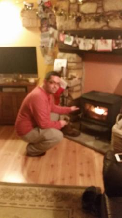 Larick House B&B: Richard sorting the log burner
