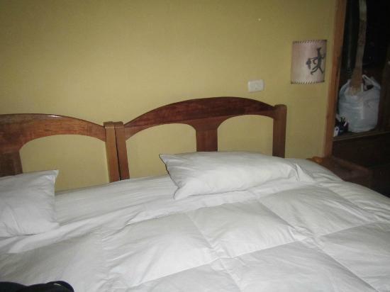 Orquidea Real Hostal: Cama de la habitación
