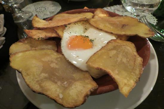 Portuguese Sausage With Potato Chips And A Fried Egg Picture Of Madragoa Cafe Lisbon Tripadvisor