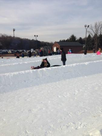 Snow Trails: Three kids recovering at end of a slide