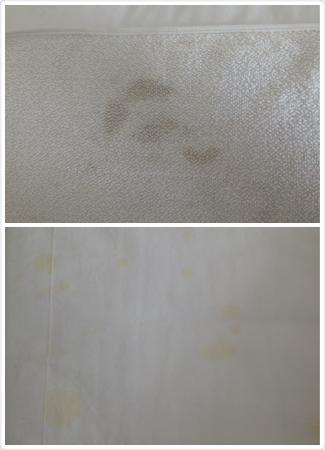 Black patches on the towel and stains on the bed sheet