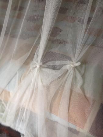 Manana Borneo Resort: Holes in the mosquito net