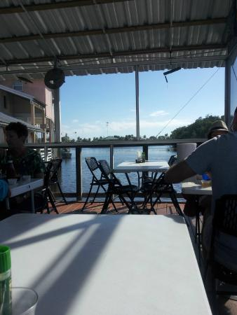 Triad Seafood Market & Cafe: View from one side of small screened-in dining area with view