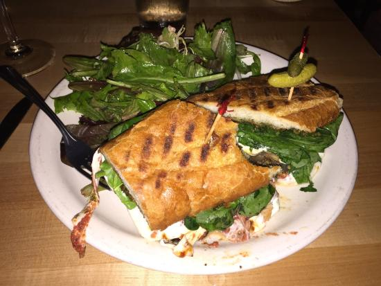 Bistro 1245: Eggplant parmigiana sandwich with Spinach, pesto and a side salad.